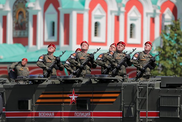 Russian servicemen are seen onboard a military vehicle during the Victory Day Parade in Red Square in Moscow, Russia on June 24, 2020. (Photo by Maxim Shemetov/Reuters)