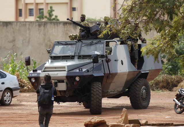 Presidential guard soldiers are seen on an armoured vehicle at Laico hotel in Ouagadougou, Burkina Faso, September 20, 2015. (Photo by Joe Penney/Reuters)