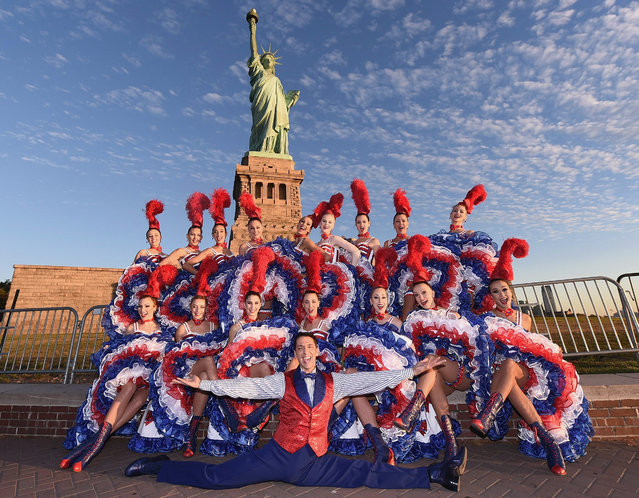Moulin Rouge Dancers visit The Statue of Liberty on September 23, 2015 in New York City. This stop was part of Moulin Rouge's first visit to New York City in its history. (Photo by Michael Loccisano/Getty Images)