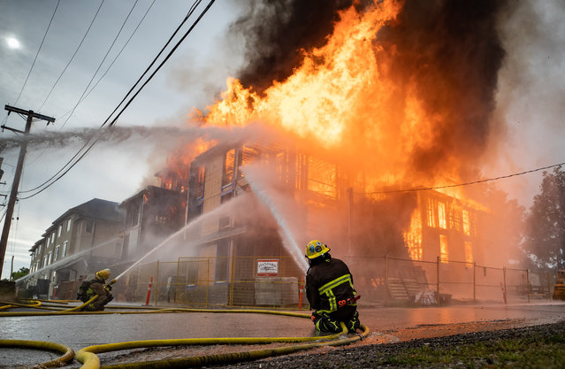 Firefighters battle a three-alarm fire at a four storey residential building under construction in Vancouver, on Thursday, June 18, 2020. (Photo by Canadian Press/Rex Features/Shutterstock)