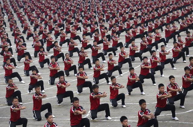 Students of Shaolin Tagou Martial Arts School perform in the opening ceremony of the Zhengzhou International Shaolin Wushu Festival at Shaolin Temple in Dengfeng, Henan province, October 19, 2014. (Photo by Reuters/Stringer)