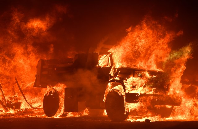 A truck burns as fire ravages the Napa wine region in California on October 9, 2017, as multiple wind-driven fires continue to whip through the region. (Photo by Josh Edelson/AFP Photo)