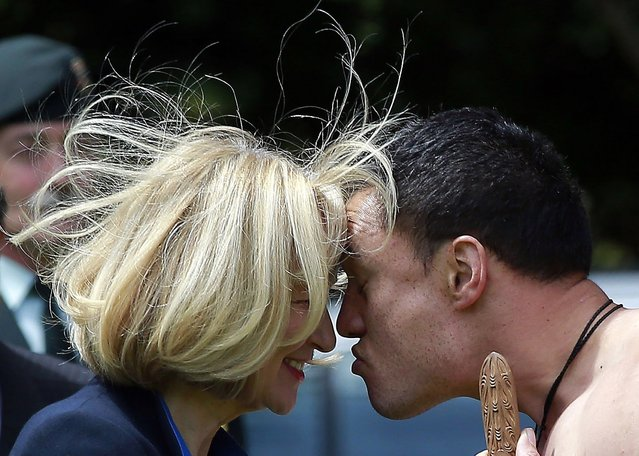 "Laureen Harper (L), the wife of Canadian Prime Minister Stephen Harper, performs a ""Hongi"" with a traditionally dressed Maori warrior during a welcoming ceremony at Government House in Auckland November 14, 2014. (Photo by Shane Wenzlick/Reuters)"