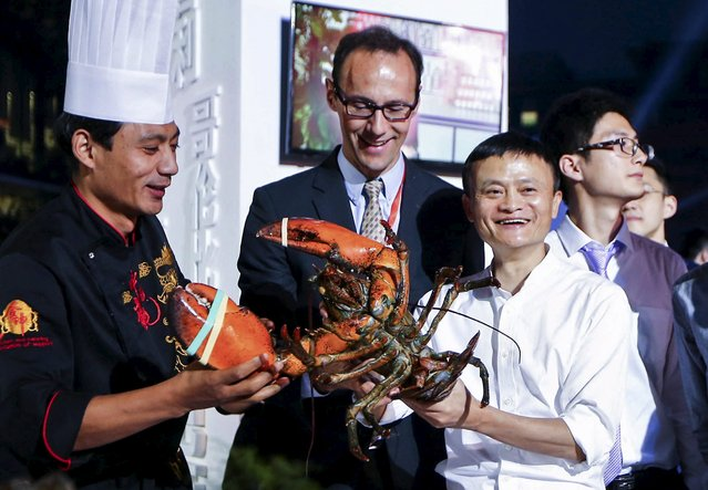 Alibaba Group's executive chairman Jack Ma (R, in white) holds a lobster at a display area for fresh food ingredient vendors, who recently signed a cooperation agreement with Alibaba's Tmall, after the launch event of Tmall 11.11 Global Shopping Festival, at the company's headquarters in Hangzhou, Zhejiang province, China, October 13, 2015. (Photo by Reuters/Stringer)