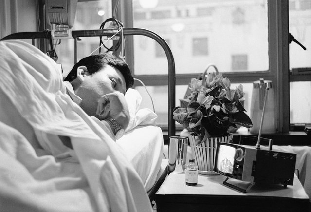 The use of small, portable TV sets in the U.S. had not quite caught on in 1963, but in Japan, where they were first developed, viewers were hooked on the miniaturized video machine. Owners of the sets, such as this patient in a Tokyo hospital, took them with them wherever they went. (Photo by Hideyuki Mihashi/AP Photo)