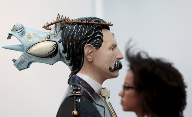 "A visitor walks past ""Erma"" by Luigi Ontani at the Frieze Art Fair in London, Britain October 14, 2015. (Photo by Suzanne Plunkett/Reuters)"