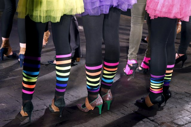 Contestants prepare to compete in a high heels race in Paris, France, October 15, 2015. The race is hosted by Sarenza, a French e-Commerce company specializing in the online sale of shoes and accessories, who celebrate is 10th anniversary. (Photo by Charles Platiau/Reuters)