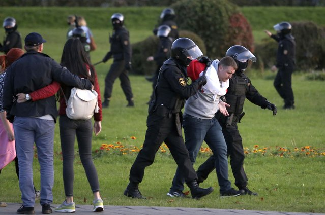 Riot police detain a protester during an opposition rally to protest the presidential inauguration in Minsk, Belarus, Wednesday, September 23, 2020. (Photo by TUT.by via AP Photo)