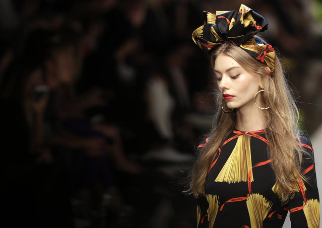 A model wears a creation for Dolce & Gabbana women's Spring-Summer 2017 collection, part of the Milan Fashion Week, unveiled in Milan, Italy, Sunday, September 25, 2016. (Photo by Antonio Calanni/AP Photo)
