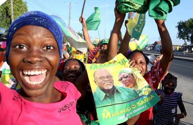 Supporters of Tanzania Presidential candidate of the ruling Chama Cha Mapinduzi (CCM) John Pombe Magufuli celebrate after he was declared the winner of the presidential election, in Dar es Salaam, October 29, 2015. Tanzania's ruling party candidate, John Magufuli, was declared winner on Thursday of a presidential election, after the national electoral body dismissed opposition complaints about the process and a demand for a recount. (Photo by Emmanuel Herman/Reuters)