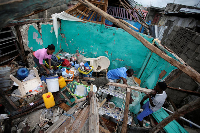 Residents work clearing a house destroyed by Hurricane Matthew in Les Cayes, Haiti, October 5, 2016. (Photo by Andres Martinez Casares/Reuters)