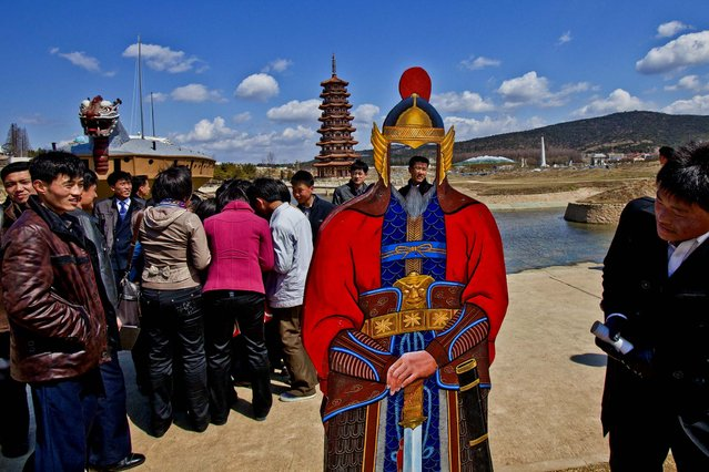 People visit the Pyongyang Folk Park on the outskirts of Pyongyang, on April 11, 2013. The park, which spans Korean history from prehistoric to modern times, opened in September 2012 after three years of construction by North Korean soldiers. (Photo by David Guttenfelder/Associated Press)