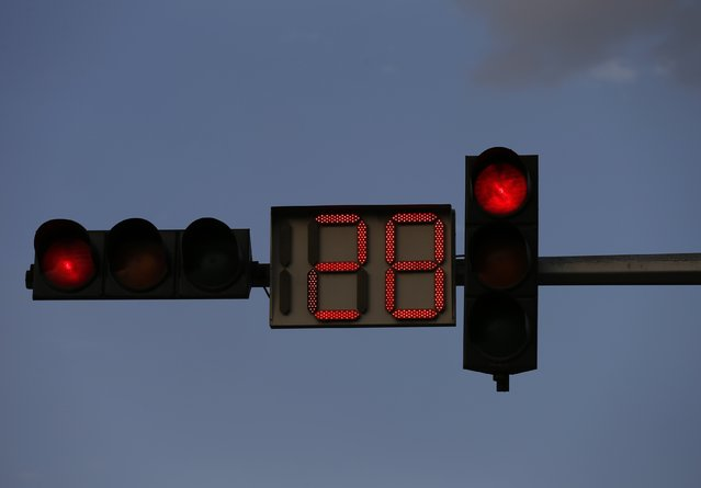 A red traffic light counts down on a street in Kabul August 31, 2014. (Photo by Mohammad Ismail/Reuters)
