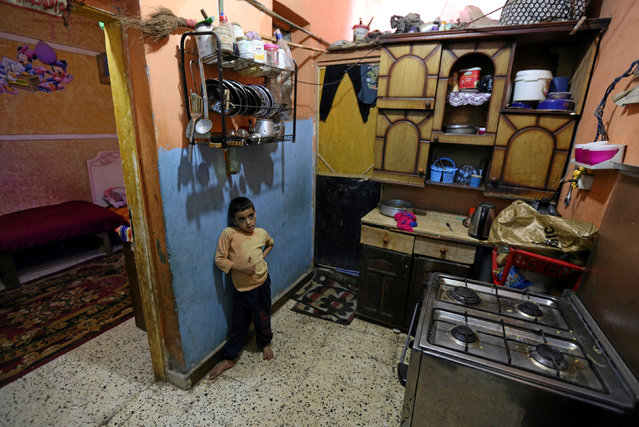 A boy from a financially strapped family is seen in his home in Ezbet Khairallah in Cairo, Egypt October 4, 2016. (Photo by Mohamed Abd El Ghany/Reuters)