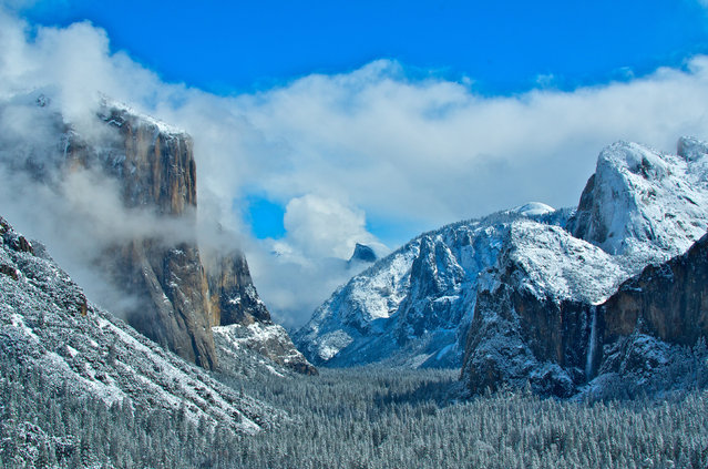 The Half Dome and valley is covered in snow in Yosemite National Park, in California. (Photo by U.S. Department of the Interior/Cater News)