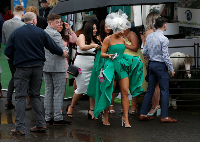 Racegoers during Ladies Day at the Grand National Festival at Aintree Racecourse on April 13, 2018 in Liverpool, England. (Photo by Andrew Yates/Reuters)