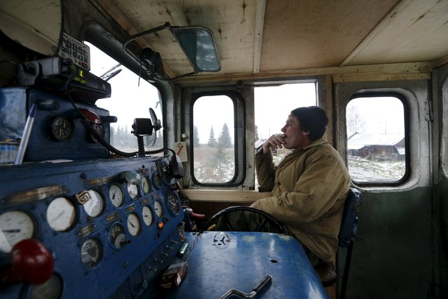 Engine driver Alexander Kuznetsov, 53, drives a train through the village of Strokinka, in Sverdlovsk region, Russia October 16, 2015. Kuznetsov's father and grandfather also worked on the railways. Only 20 people live in the village of Strokinka. (Photo by Maxim Zmeyev/Reuters)