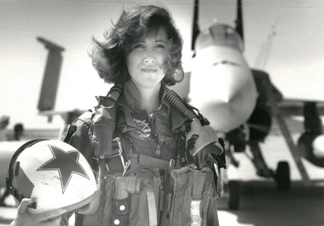 U.S. Navy Lieutenant Tammie Jo Shults, who is currently a Southwest Airlines pilot, poses in front of a Navy F/A-18A in this 1992 photo released in Washington, DC, U.S., April 18, 2018. (Photo by Thomas P. Milne/Reuters/U.S. Navy)