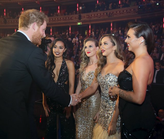 Britain's Prince Harry greets members of Little Mix after the Royal Variety Performance at the Albert Hall in London, November 13, 2015. (Photo by Paul Hackett/Reuters)