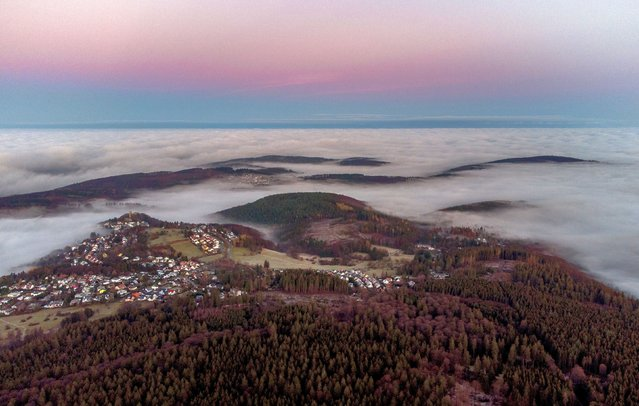 Clouds and fog are seen over villages in the Taunus hills near Frankfurt, Germany, Tuesday, November 24, 2020. (Photo by Michael Probst/AP Photo)