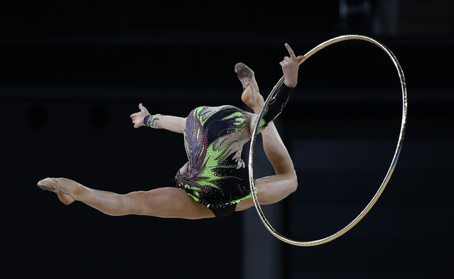 Laura Halford of Wales jumps during her hoop routine as she competes in the rhythmic gymnastics individual all-around final event at the 2014 Commonwealth Games in Glasgow, Scotland, July 25, 2014. (Photo by Phil Noble/Reuters)