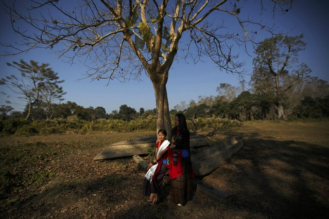 Women pose as their friend (unseen) takes picture at Chitwan National Park in Chitwan, south of Kathmandu December 30, 2014. (Photo by Navesh Chitrakar/Reuters)