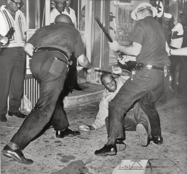 An incident at 133rd Street and Seventh Avenue during the Harlem Riot of 1964. (Photo by Dick DeMarsico/New York World Telegraph & Sun)