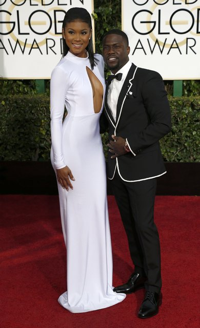 Actor Kevin Hart (R) and model  Eniko Parrish arrive at the 72nd Golden Globe Awards in Beverly Hills, California January 11, 2015. (Photo by Mario Anzuoni/Reuters)