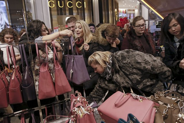 Women shop for handbags at Macy's Herald Square store during the early opening of the Black Friday sales in the Manhattan borough of New York, November 26, 2015. (Photo by Andrew Kelly/Reuters)