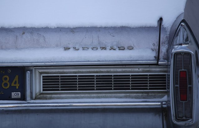 An older model of a Cadillac Eldorado vehicle sits in a parking lot in Detroit, Michigan January 7, 2015. (Photo by Joshua Lott/Reuters)