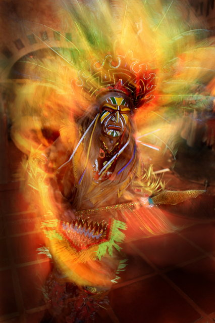 """""""Dance with the Fire"""". Peruvian folklore dancer in the city of Cuzco, wearing a traditional carnival costume. Location: Cuzco, Peru. (Photo and caption by Dirk Kanz/National Geographic Traveler Photo Contest)"""