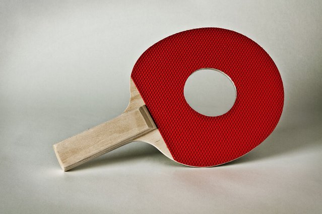 A ping pong paddle with a hole in it. (Photo by Giuseppe Colarusso/Caters News)