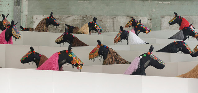 Dancers dressed as a horses parade down a ramp during a press preview of American artist Nick Cave's first major work shown in Australia, entitled HEARD.SYD in Sydney, November 8, 2016. (Photo by Jason Reed/Reuters)
