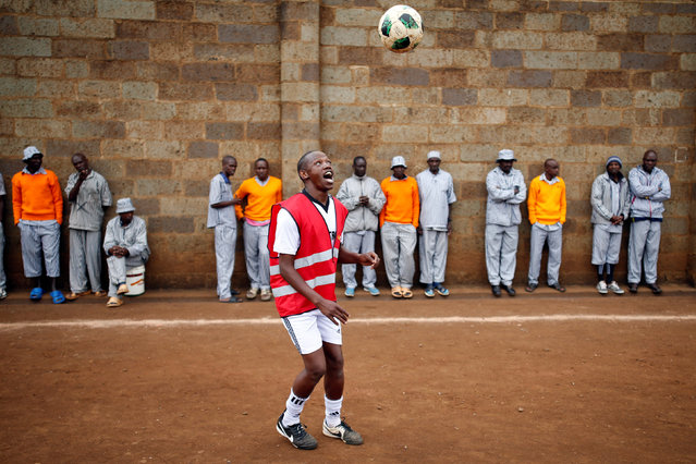 A prisoner warms up before the start of a mock World Cup soccer match between Russia and Saudi Arabia, as part of a month-long soccer tournament involving eight prison teams at the Kamiti Maximum Prison, Kenya's largest prison facility, near Nairobi, Kenya, June 14, 2018. (Photo by Baz Ratner/Reuters)