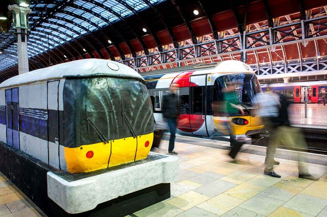 To celebrate the 15th anniversary of Heathrow Express a huge cake shaped train was installed at Paddington station in London, on June 22, 2013. (Photo by REX/SIPA)