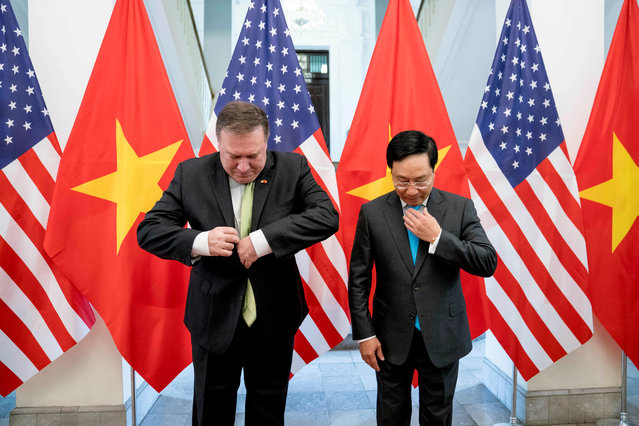 U.S. Secretary of State Mike Pompeo and Vietnamese Deputy Prime Minister and Foreign Minister Pham Binh Minh arrive for a photo opportunity before a meeting at the Ministry of Foreign Affairs in Hanoi, Vietnam on July 9, 2018. (Photo by Andrew Harnik/Reuters)