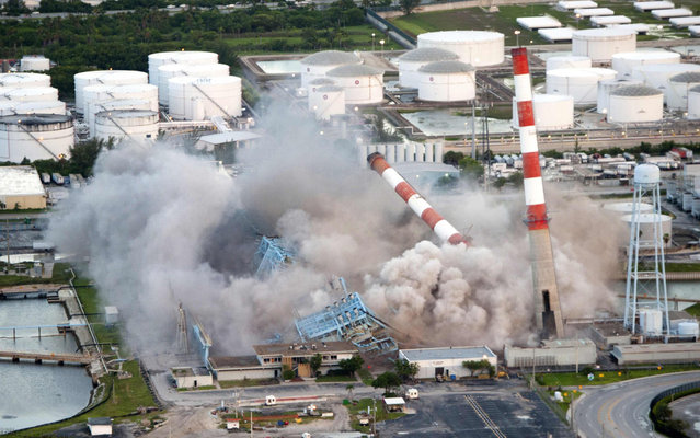 Four 350-feet-tall smoke stacks and boilers are demolished by Florida Power and Light Company (FPL) at its Port Everglades power plant in Hollywood, Florida,July 16, 2013 in this picture provided by Florida Power and Light Company.  The demolition was done to make way for a new, high-efficiency, clean power plant. Scheduled to open in 2016, the new, state-of-the-art combined-cycle natural gas plant will produce enough electricity to power approximately 260,000 homes while using 35 percent less fuel than the old power plant, according to FPL. (Photo by Brian Blanco/Reuters/Florida Power and Light)