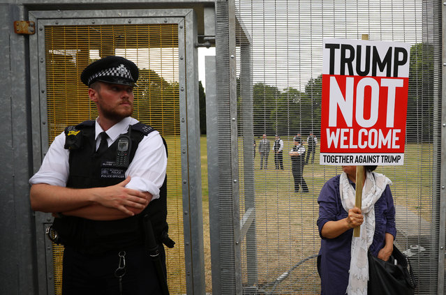 A demonstrator protests next to the specially erected fence surrounding the U.S. ambassador's residence, Winfield House, where U.S. President Donald Trump and the first lady Melania Trump are staying, in London, July 12, 2018. (Photo by Simon Dawson/Reuters)