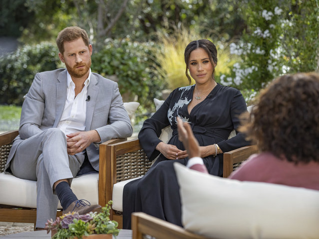 """This image provided by Harpo Productions shows Prince Harry, left, and Meghan, Duchess of Sussex, in conversation with Oprah Winfrey. """"Oprah with Meghan and Harry: A CBS Primetime Special"""" airs March 7, 2021. Britain's royal family and television have a complicated relationship. The medium has helped define the modern monarchy: The 1953 coronation of Queen Elizabeth II was Britain's first mass TV spectacle. Since then, rare interviews have given a glimpse behind palace curtains at the all-too-human family within. (Photo by Joe Pugliese/Harpo Productions via AP Photo/File)"""