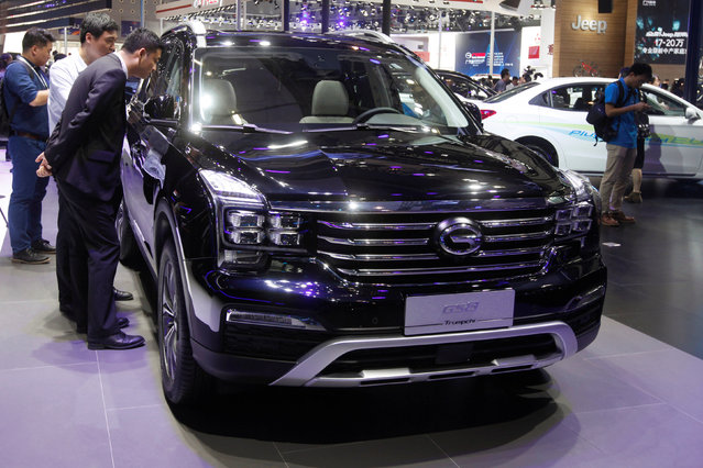 People look at GS8 by Trumpchi from GAC Group at China (Guangzhou) International Automobile Exhibition in Guangzhou, China November 18, 2016. (Photo by Bobby Yip/Reuters)