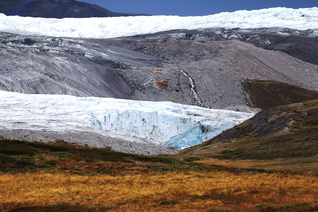 A glacier near Kangerlussuaq, Greenland, photographed on July 13, 2013. (Photo by Joe Raedle/Getty Images via The Atlantic)