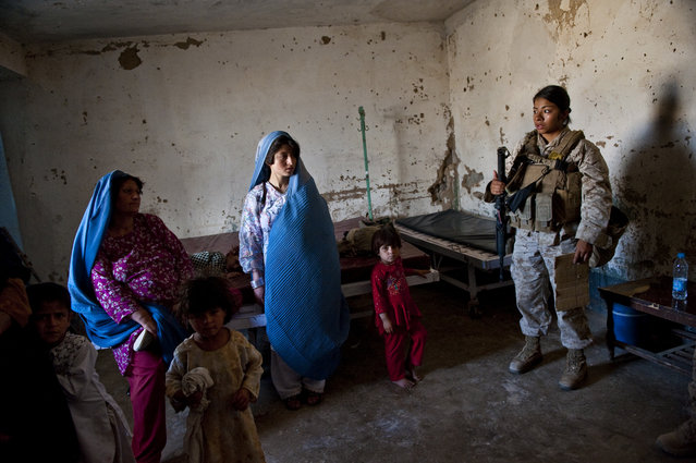 United States Marines with the Female Engagement Teams attached to infantry divisions of the Marines visit the clinic in Now Zad, in Northern Helmand, May 8, 2010. (Photo by Lynsey Addario/The New York Times)