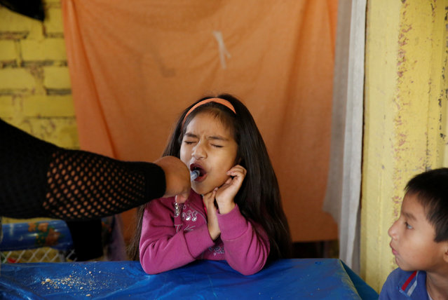 Jazmin, 6, sister of Jose Luis, receives Isoniazid Preventive Therapy in Carabayllo in Lima, Peru July 14, 2016. (Photo by Mariana Bazo/Reuters)