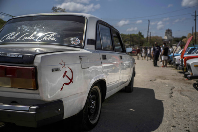 A Soviet-era Lada car with a hammer and sickle sticker is driven to the Lada Cuba Club meeting in Havana, Cuba, Sunday, March 21, 2021. Russians stopped making this model in September 2012, however, a line remained in production in Egypt until 2015. (Photo by Ramon Espinosa/AP Photo)