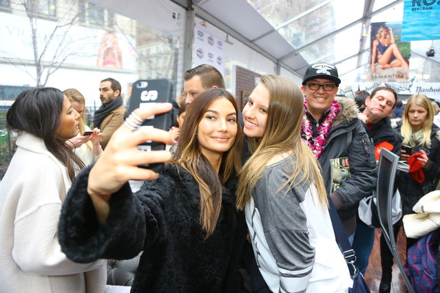 Sports Illustrated swimsuit model Lily Aldridge takes a selfie with a fan at the SwimCity festival in New York City on Monday February 9, 2015. (Photo by Gordon Donovan/Yahoo News)