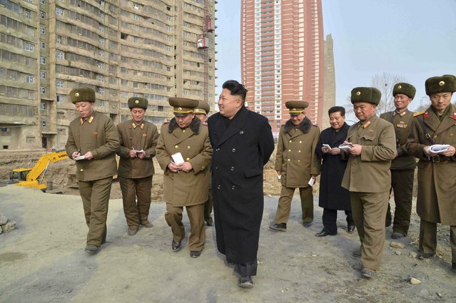 North Korean leader Kim Jong Un (C) visits the construction site of the Mirae Scientists Street in Pyongyang in this undated photo released by North Korea's Korean Central News Agency (KCNA) in Pyongyang February 15, 2015. (Photo by Reuters/KCNA)