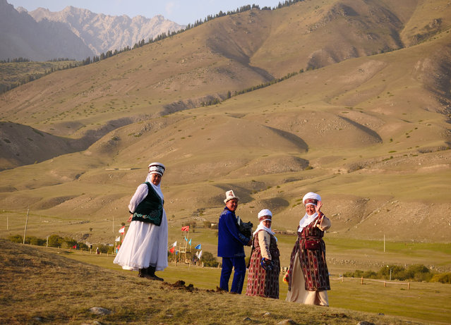Kyrgyz in traditional clothing. (Photo by Amos Chapple/Radio Free Europe/Radio Liberty)