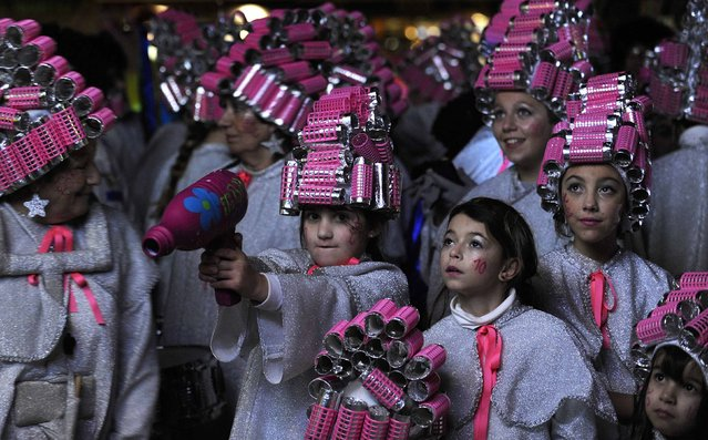 A group of girls stand together dressed with curler decorations during the Carnival parade in Gijon, northern Spain,  February 17, 2015. (Photo by Eloy Alonso/Reuters)