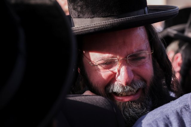 An Ultra-Orthodox Jewish man mourns during the funeral of Yehuda Leib Robin, who died during Lag B'Omer commemorations on Mount Meron, in Jerusalem April 30, 2021. (Photo by Ronen Zvulun/Reuters)
