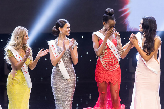 Miss Kenya Evelyn Njambi Thungu (2nd-R) reacts after being named a finalist during the Grand Final of the Miss World 2016 pageant at the MGM National Harbor December 18, 2016 in Oxon Hill, Maryland. (Photo by Zach Gibson/AFP Photo)